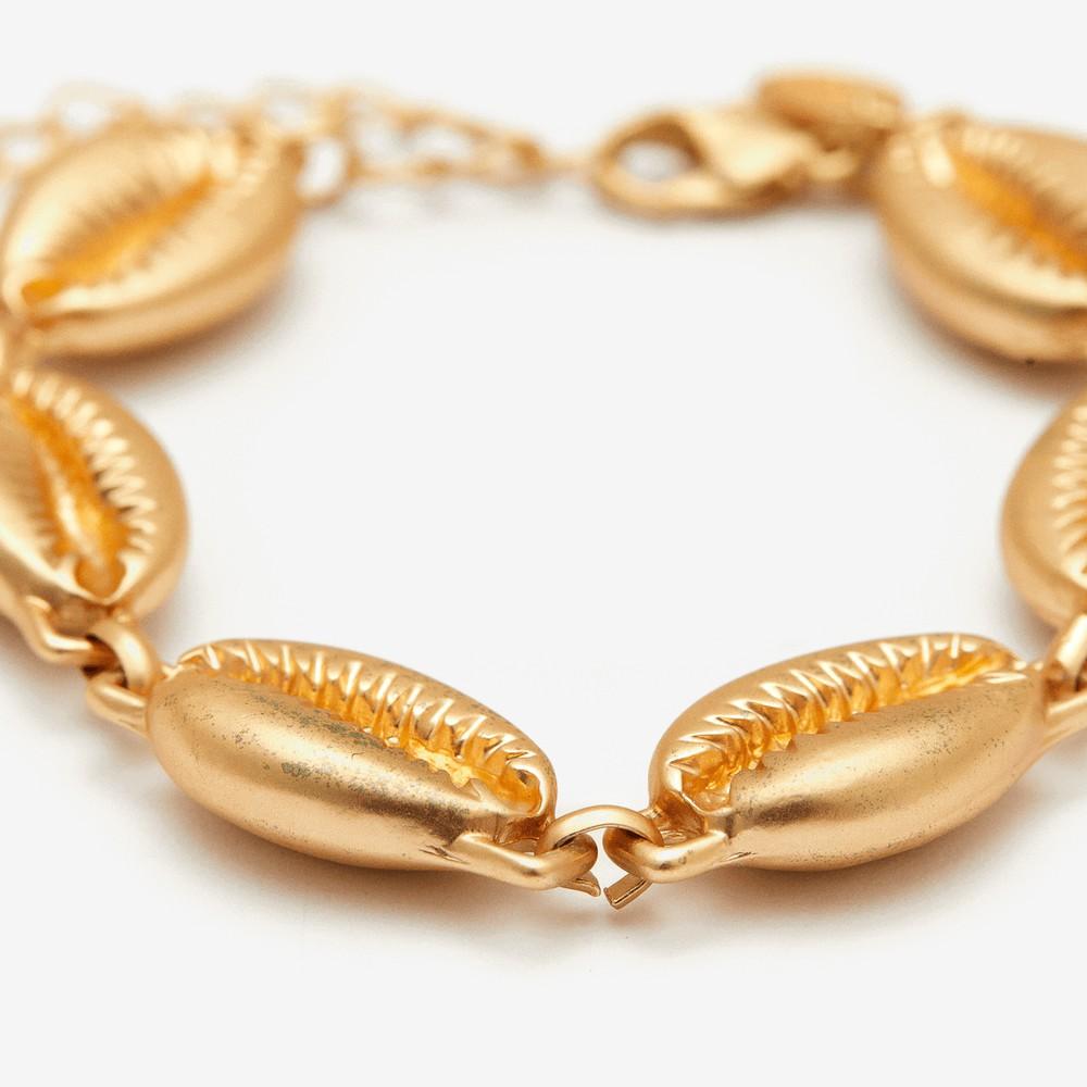 Pulsera conchitas de mar doradas