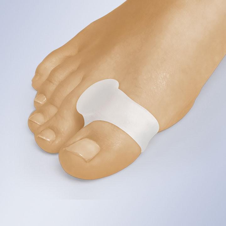 Separador de dedo con anillo
