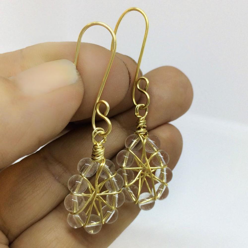 Aro dorado con cristal 5 cm de largo