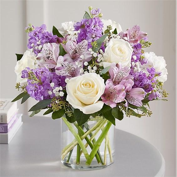"Lovely lavender Medium arrangement measures approximately 13""H x 12""L"