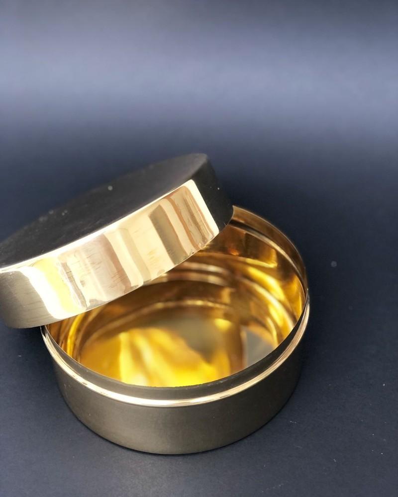 Caja redonda oro