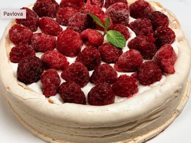 Pavlova de merengue, manjar, frambuesa