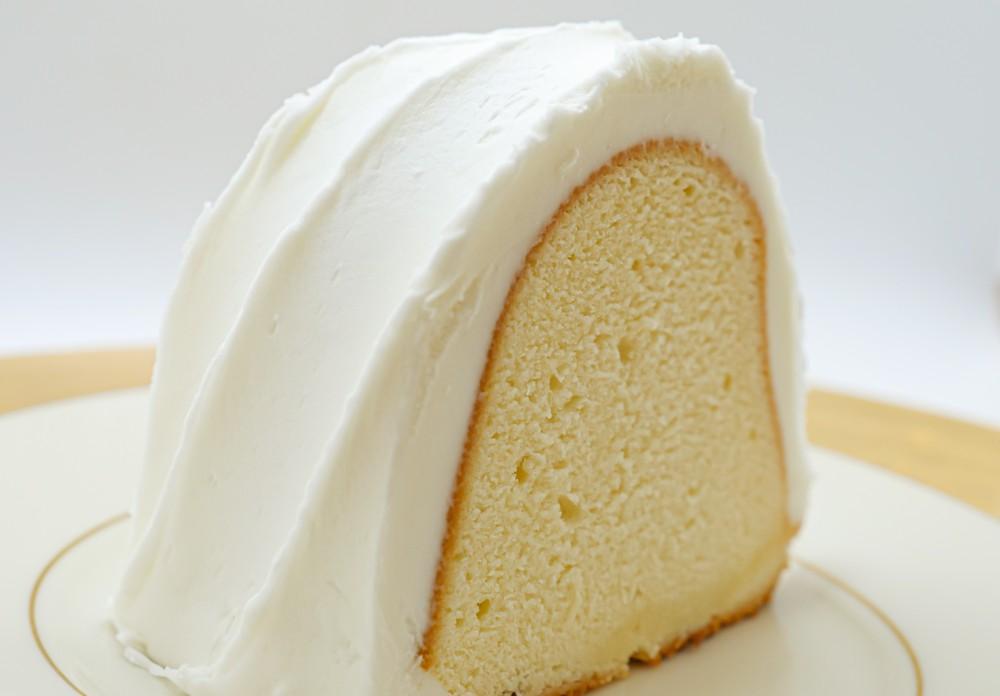 Lemon pound cake with vanilla icing slice Slice