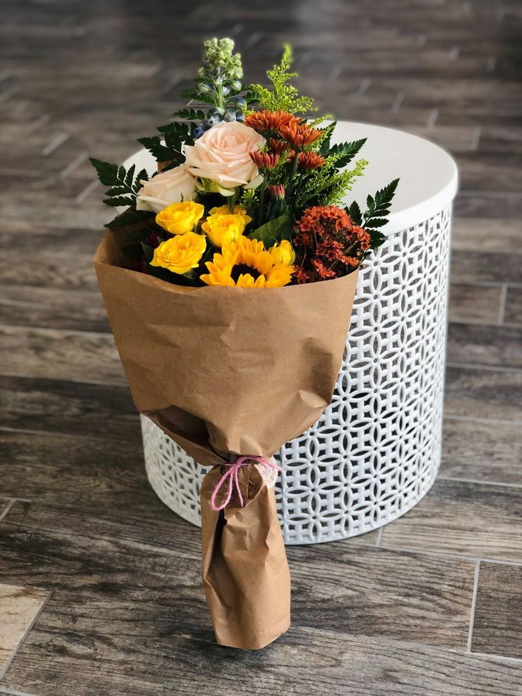 Small wrapped seasonal flowers