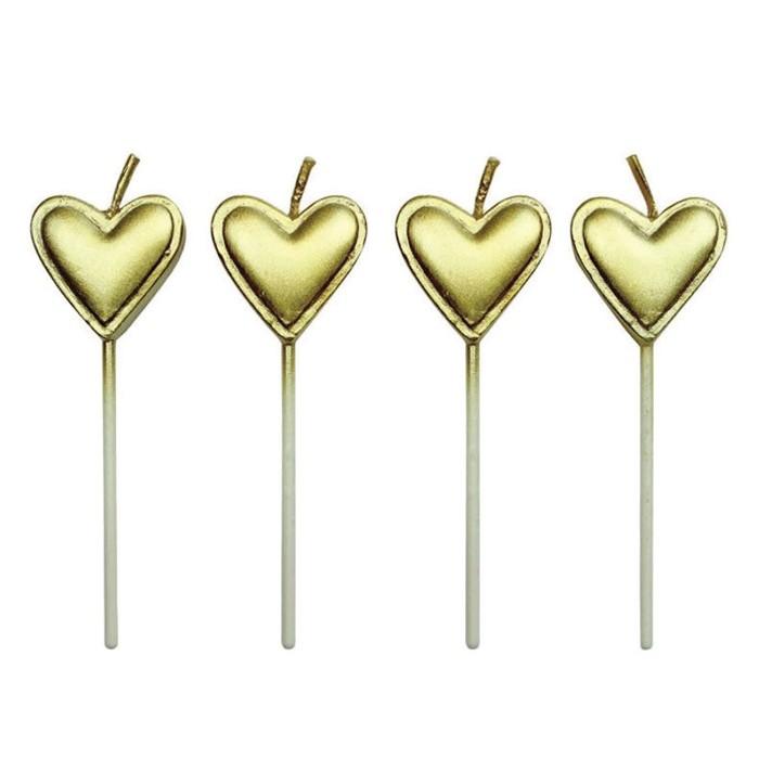 Velas corazones doradas