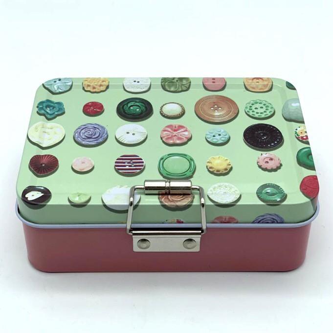Costurero metálico botones